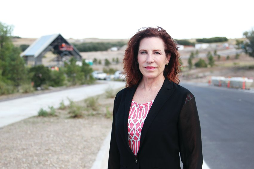 Castle Pines Mayor Tera Radloff stands near what will be the entrance to The Canyons, a developing neighborhood in the city.