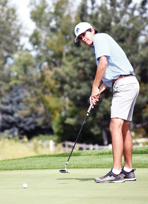 Ralston Valley junior Jack Larson hits a putt on his back-nine Tuesday, Sept. 17, at The Broadlands Golf Course. Larson finished as the Class 5A Jeffco League runner-up in the individual standings with a stroke average of 71.6 in conference tournaments.