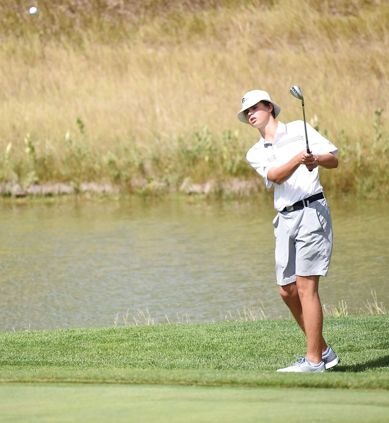 Green Mountain junior Ollie Gibbons hits a chip during the closing few holes Tuesday, Sept. 17, at The Broadlands Golf Course. Gibbons finished third in the Class 4A Jeffco League individual standings this fall.