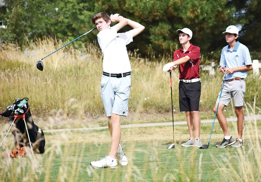 Lakewood sophomore Max Lange, left, watches his drive on No. 13 along playing partners — Chatfield's Max Heupel and Ralston Valley's Jack Larson — during the Jeffco League tournament finale Tuesday, Sept. 17,  at The Broadlands Golf Course.