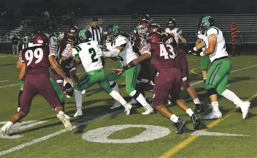 Sept. 19 at Five Star Stadium, the Horizon defense surrounds the ThunderRidge ball carrier.