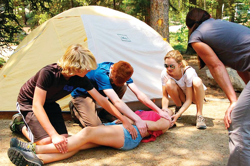 Participants of a past Wilderness First Aid Course offered by the Colorado Mountain Club learn how to move an injured person. The club's Colorado Mountain Fest takes place Sept. 28 and 29 at the American Mountaineering Center, 710 10th St., in Golden.