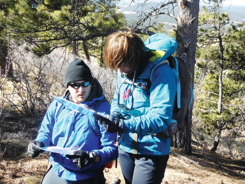 Two people practice their orienteering skills during a past Colorado Mountain Club Navigation Course. The club's Colorado Mountain Fest takes place Sept. 28 and 29 at the American Mountaineering Center, 710 10th St., in Golden.
