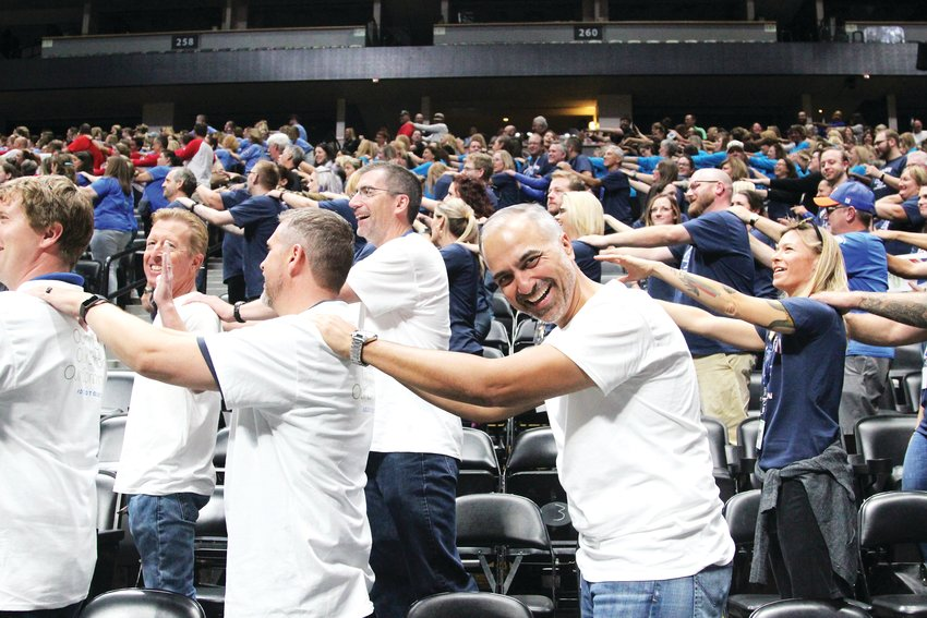Chief Technology Officer Gautam Sethi laughs as Douglas County School District cabinet members participate in ice breakers at the district's rollout of its new strategic plan. The event took place at the Pepsi Center in Denver and was attended by thousands of district employees.