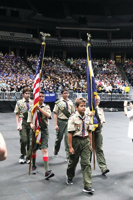 Boy scouts enter the Pepsi Center arena at the start of the Douglas County School District's strategic plan launch.