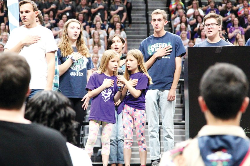 South Ridge Elementary students Evelyn and Zoe Brigalia lead the Pledge of Allegiance.