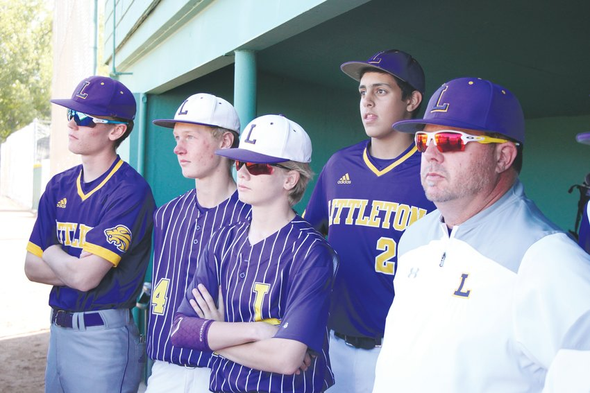 A new generation of Littleton High School baseball players look on as their predecessors honor former coach Willie White.