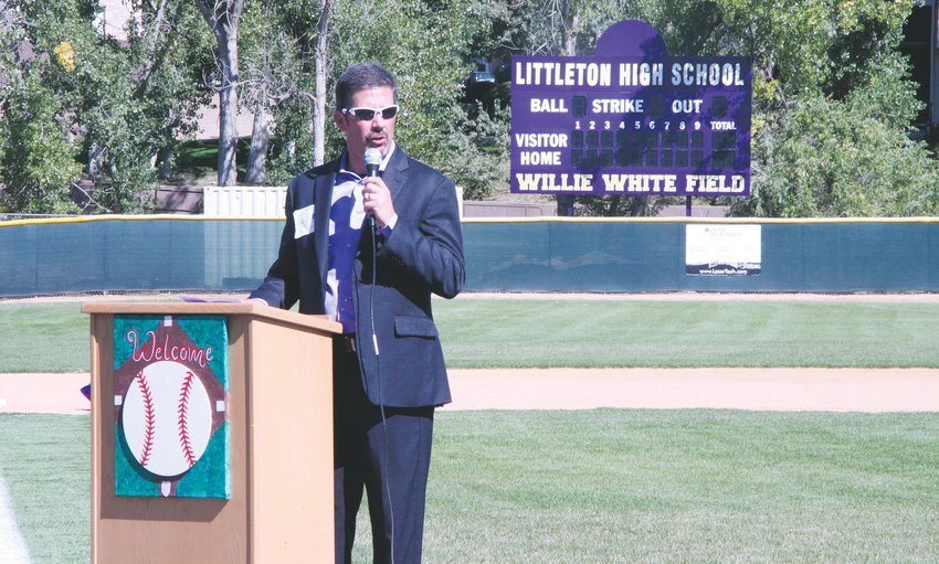 Donnie Alexander, who pitched on the LHS varsity team as a teen, speaks at the field's rededication ceremony.