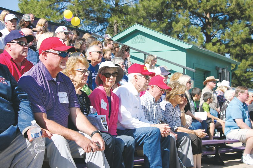 People whose lives were touched by Littleton High School baseball coach Willie White watch as the school's field is renamed in his honor.