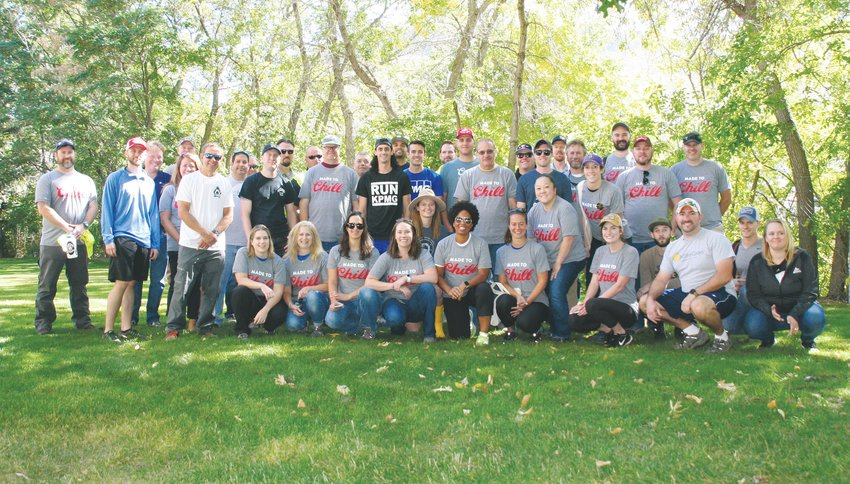 Some of the nearly 150 volunteers for the MolsonCoors annual Clear Creek cleanup gather for a group picture just before their lunch break on Sept. 26.