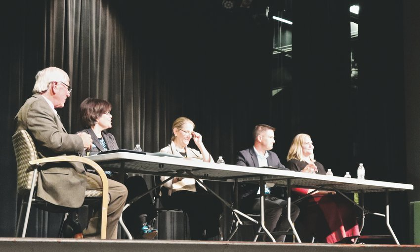 Moderator Dave Thomas, left, poses a question to the four school board candidates during the Jeffco PTA Candidate Forum, held at Lakewood High School. Candidates from left to right: Joan Chávez-Lee, District 4; Susan Miller, District 4; Rob Applegate, District 3; Stephanie Schooley, District 3.