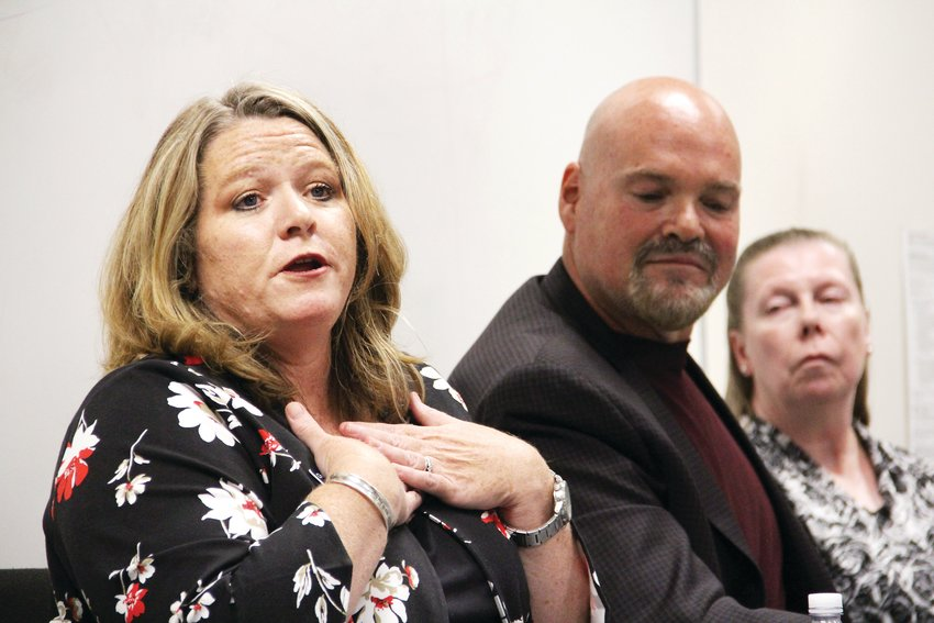 Christine Sweetland, a District 2 candidate, speaks at the Sept. 23 Centennial City Council candidate forum. Next to her, Richard Holt, middle, and Rhonda Livingston, both District 3 candidates, listen.