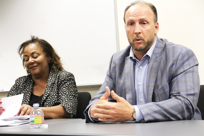District 2 candidate Brian Beatty, right, speaks at the Centennial City Council candidate forum, as incumbent District 1 Councilmember Candace Moon listens.