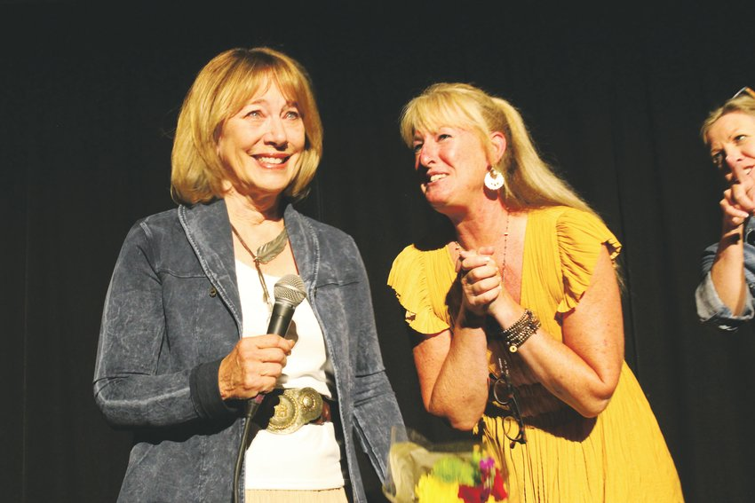 Jennifer La Berge wins the 2019 Volunteer of the Year award at the 5th annual Tall Tales Ranch Hoedown at CU South Denver Sept. 28. She is accompanied by Cathy Law, Tall Tales Ranch board president.