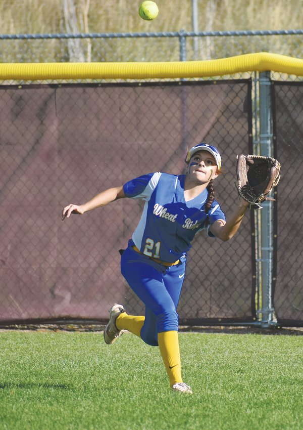 Wheat Ridge junior Aliyah Rothstein makes a running catch during the Class 4A top-4 showdown Sept. 27 at Golden High School.