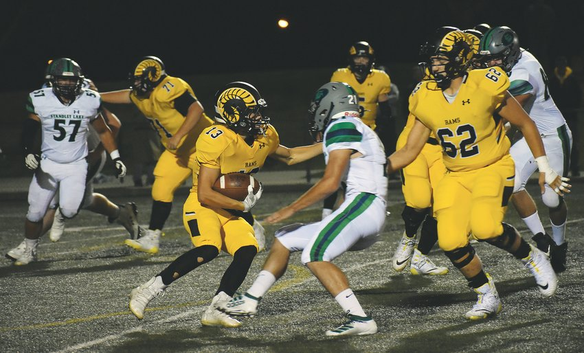 Green Mountain senior Trey Corkin (13) weaves his way through traffic in the Rams' victory over Standley Lake on Sept. 27 at Trailblazer Stadium.