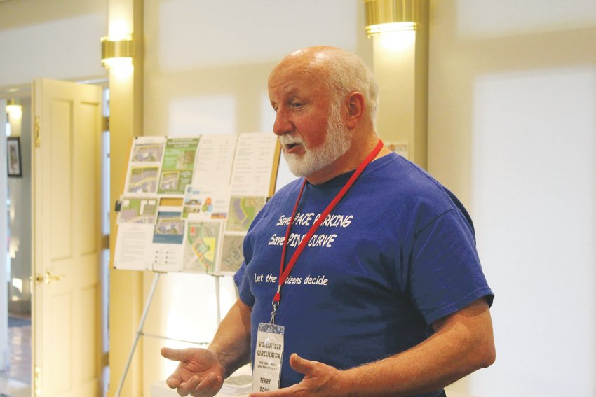 Terry Dodd speaks during an Aug. 26 rally for the Save PACE Parking and Pine Curve 3.0 committee.