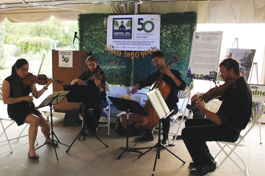 A string quartet plays at the CHUN 50th anniversary event, which was held at the Denver Botanic Gardens on Sept. 18. The event also held a silent auction to raise funds for the nonprofit.