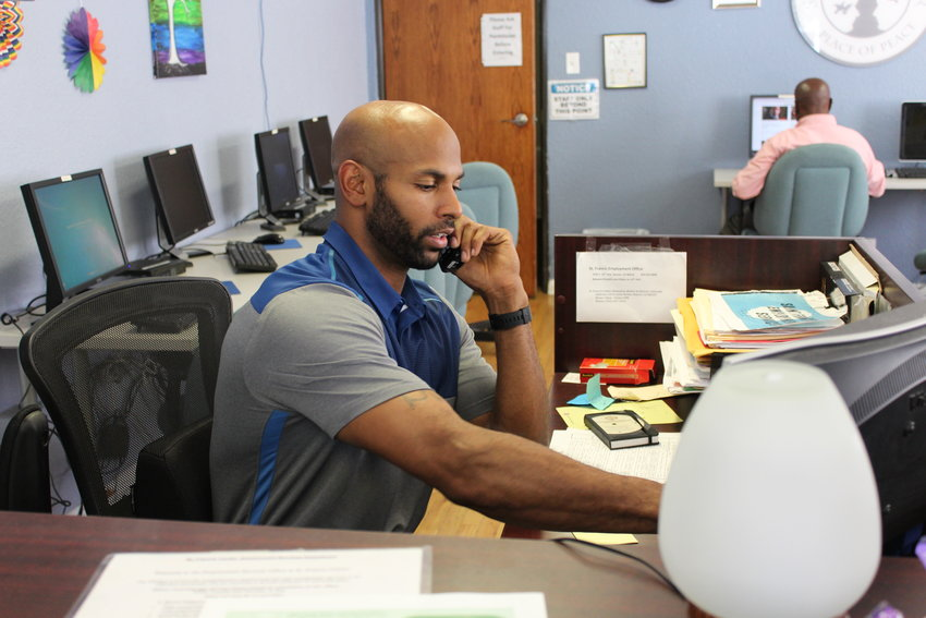 Ved Price answers the phone at the St. Francis Center Employment Services office. The nonprofit has run employment services inside the Warren Methodist Church for the last 10 years. It helps homeless individuals to find jobs.