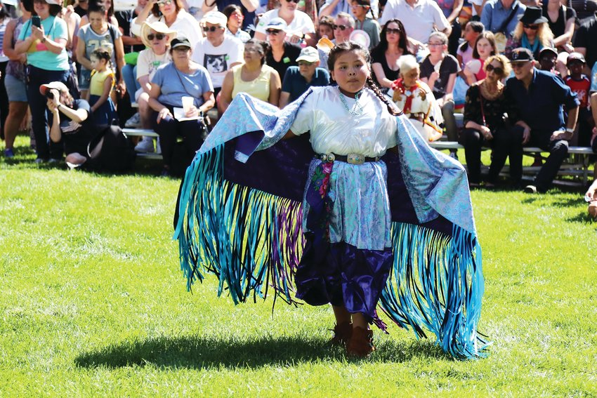 Kylie Charles, of Westminster, represents the Diné (Navajo) tribe in the junior girls fancy dance at the 30th annual Friendship Powwow.