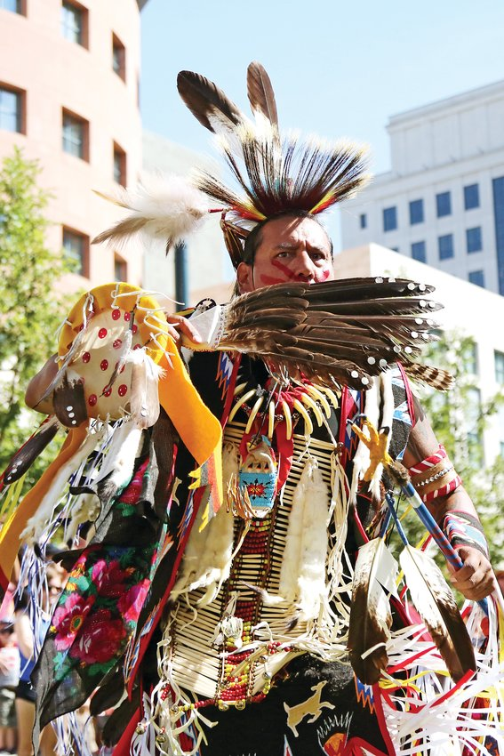 Gerald Montour, of Northglenn, dances during the grand entry at Friendship Powwow.