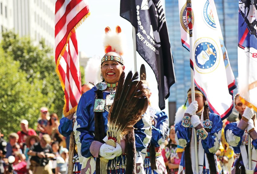 Mitchelene BigMan leads the Native American Women Warriors, the first ever recognized all Native American Women Color Guard. The purpose of NAWW is to bring recognition to all women veterans, especially those of Native American descent, and their contribution to the military.