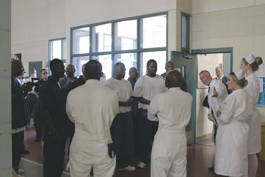"Cast members greet inmates who will make up the audience for the performance of ""One Flew Over the Cuckoo's Nest."" Hamilton said that it was a huge undertaking to organize the performance in different prisons, as well as to figure out transport of the inmates and set from one prison to another."