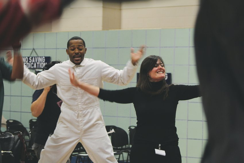 "Ashley Hamilton, right, gets the actors ready for their performance at the Denver Women's Correctional Facility. Hamilton directed ""One Flew Over the Cuckoo's Nest"" and is also the director of the Prison Arts Initiative at DU."