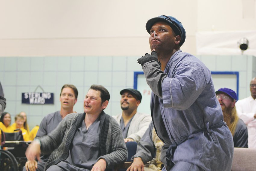 "Terriano Davis, right, during the September performance of ""One Flew Over the Cuckoos Nest."" The Prison Arts Initiative is expanding into 10 prisons in Colorado. The program also runs a podcast called With(in) and a newspaper throughout the Colorado Department of Corrections."