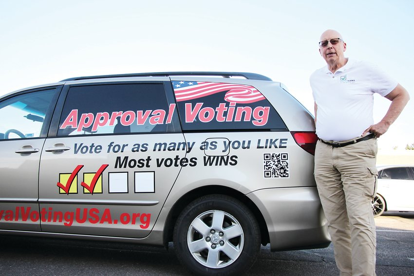 Frank Atwood, the chairman of the Approval Voting Party, stands beside his minivan, a sort of rolling billboard. The party achieved minor party status in Colorado in October, meaning it will automatically appear on presidential ballots in years to come. The party seeks to institute what it calls a more equitable voting method.
