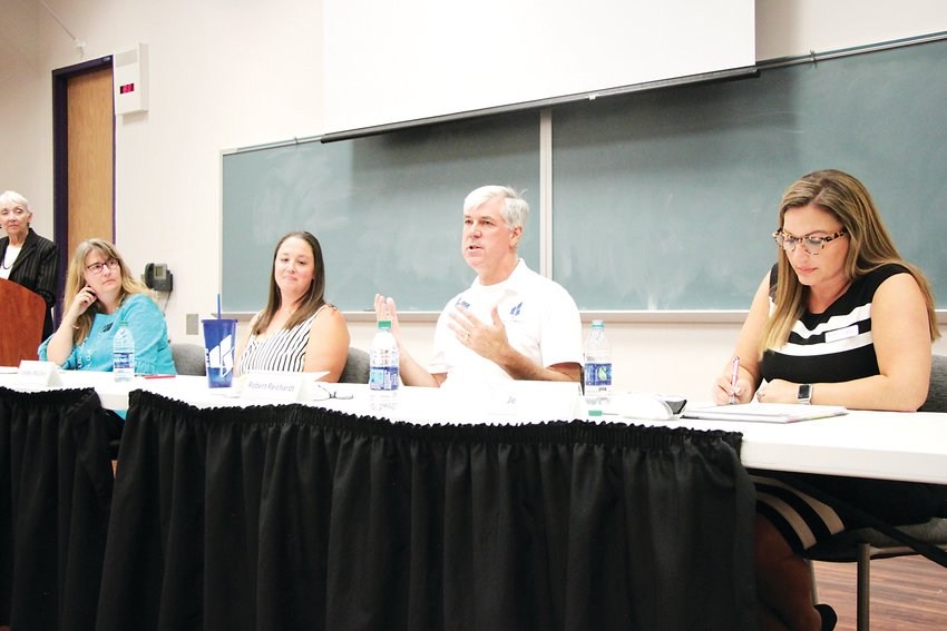 The four candidates for two seats on Littleton Public Schools' Board of Education met for a candidate forum on Sept. 30. From left: Crysti Copp, Lindley McCrary, Robert Reichardt and Jessica Roe.