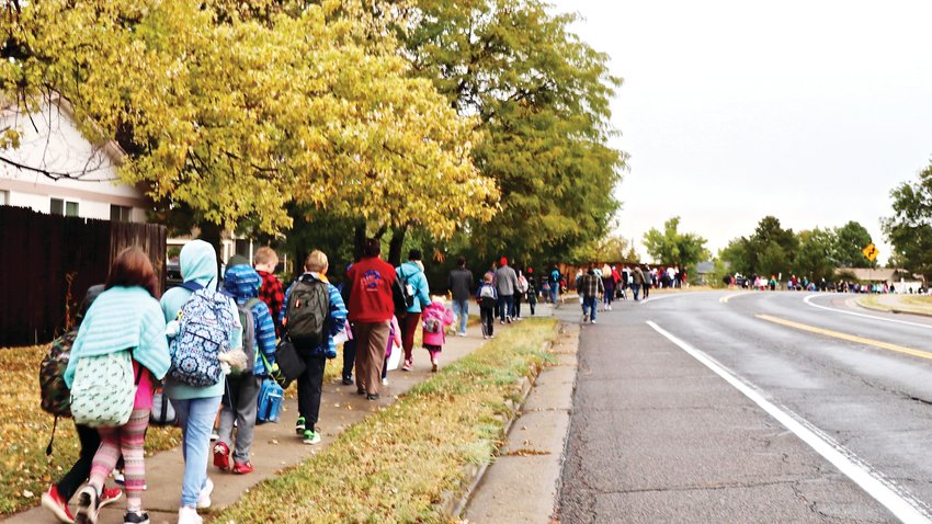 The line of students and family members stretches down Carr Drive. The tradition attracts about 150 participants every year, but this year's event appeared to attract an even bigger crowd than usual, principal Matt Hilbert said.