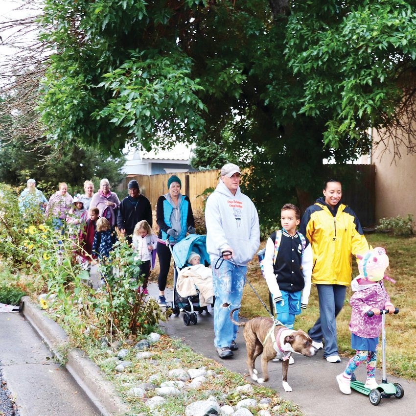 Quite a few parents, younger siblings and pets joined in on the walk to Warder Elementary on National Walk to School Day.
