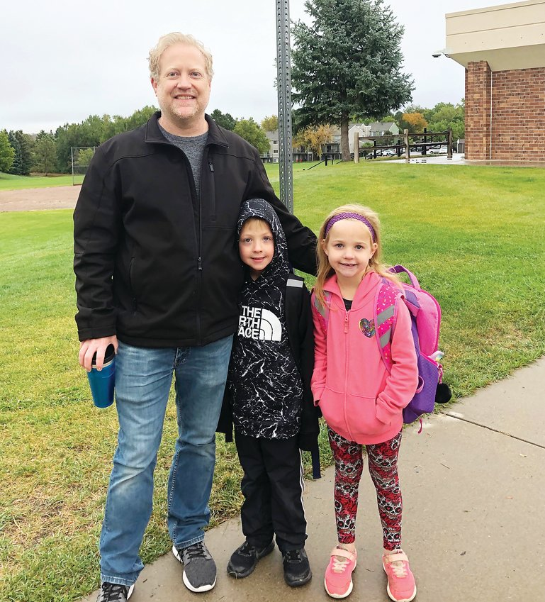 "Clay Sewald and his kids, Warder kindergarteners Carson and Kaylee, participated in their first Walk to School Day this year. ""My favorite part (of the day) was walking to school and taking pictures because it's so fun,"" Carson said."