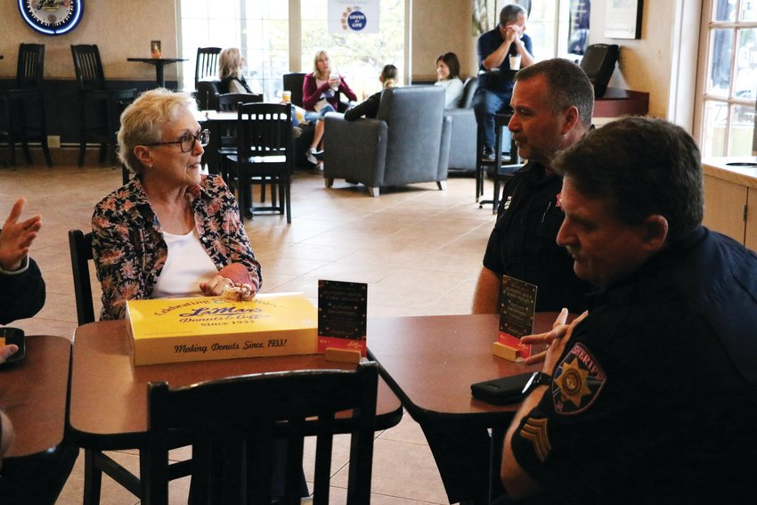 "Douglas County deputies talk with a resident during the ""Coffee with a Cop"" event Oct. 2."