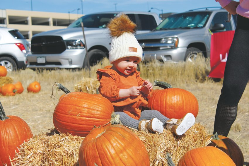 Pumpkins of all shapes and sizes abounded at Schweiger Ranch Oct. 5 for the annual fall festival. Ten-month-old Presley Miesbauer poses for a fall pic looking very pumpkin-like.