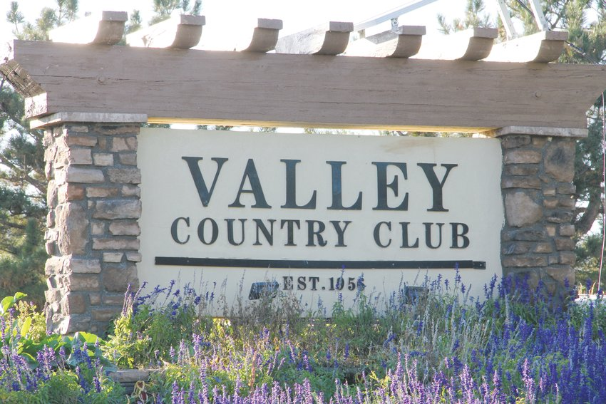 A sign for the Valley Country Club sits near East Arapahoe Road and South Chambers Way on Oct. 2. The club's golf course is right next to a small Centennial neighborhood.