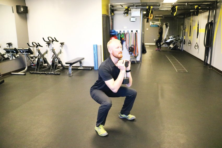 Cameron Davis, owner of RockStar Fitness in Castle Rock, completes a goblet squat using a dumbbell. One can also use a kettlebell, he said.