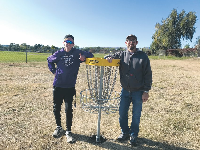 Cruz Lopez, left, and Drake Middle School teacher Adam Donohue stand on the completed Frisbee golf course. Lopez recruited volunteers to build the course at Drake over the weekend of Oct. 5 as part of his Eagle Scout project.