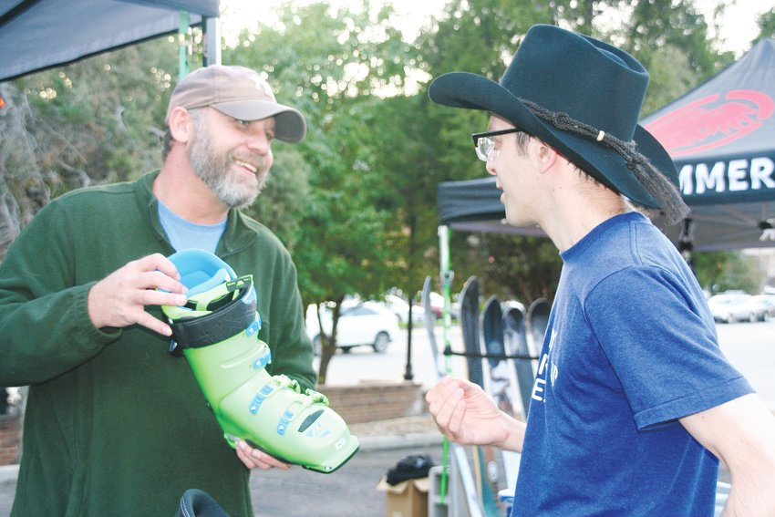 Duke Hogan, left, a representative for Lange ski boots, talks with Matt Alexander of Golden about Lange's XT FREE 130 ski boot during the Ski Expo at Bentgate Mountaineering's 2019 Ski Season Kick-off Party.