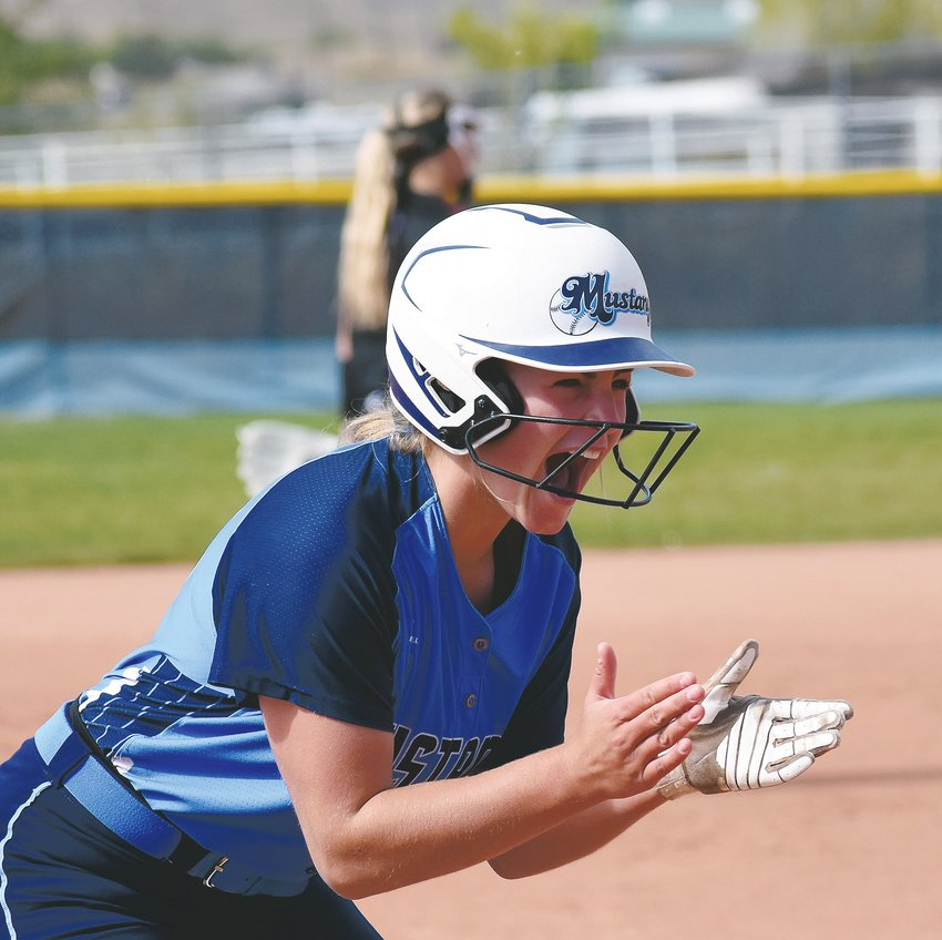 Ralston Valley sophomore Maya Bachman is fired up after her triple in the fifth inning Saturday, Oct. 5, against Chatfield. The Mustangs ended a 2-game losing streak with the home victory over the Chargers.