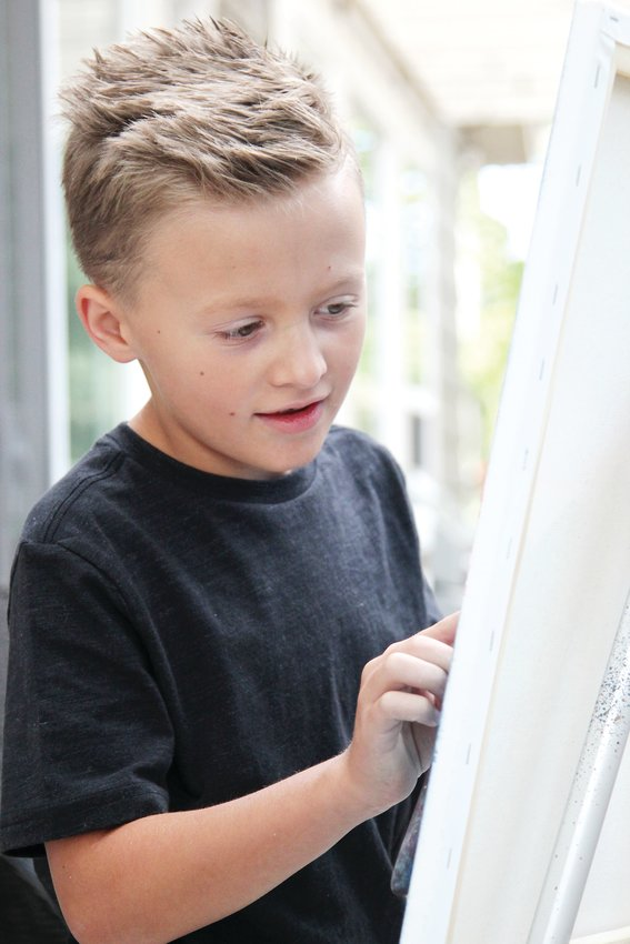 Titus Clinger, 8, paints at his home in Castle Rock on Oct. 8.