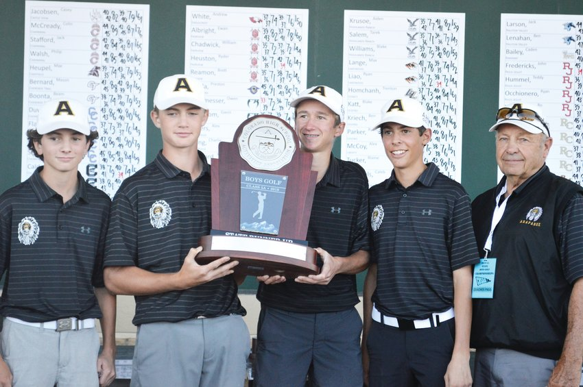 The Arapahoe boys golf team holds its second-place trophy at the Boys State High School Golf Championships held at Pinehurst Country Club.