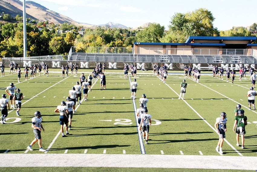 The Colorado School of Mines Orediggers warm up during practice on Oct. 8. The greater community is invited to celebrate homecoming with Mines during its homecoming parade and football game on Oct. 19.