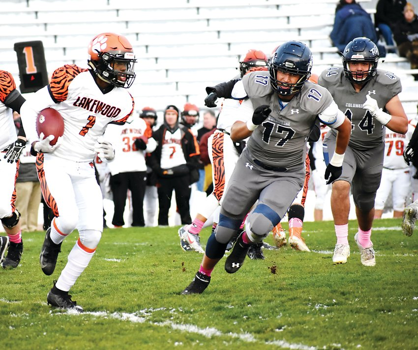 Lakewood senior Keondre Beauty (1) is pursued by Columbine seniors Justin Lohrenz (17) and Stephen Hughes (44) during the first quarter Oct. 10 at Jeffco Stadium. Beauty had a touchdown catch late in the game for the Tigers, but it wasn't enough as Lakewood lost 42-18.