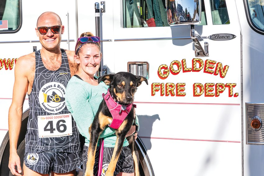 First place finishers Jared Green and Katie Carbiener, with her dog Tory, catch their breath after the GOGO Goosetown 5K.