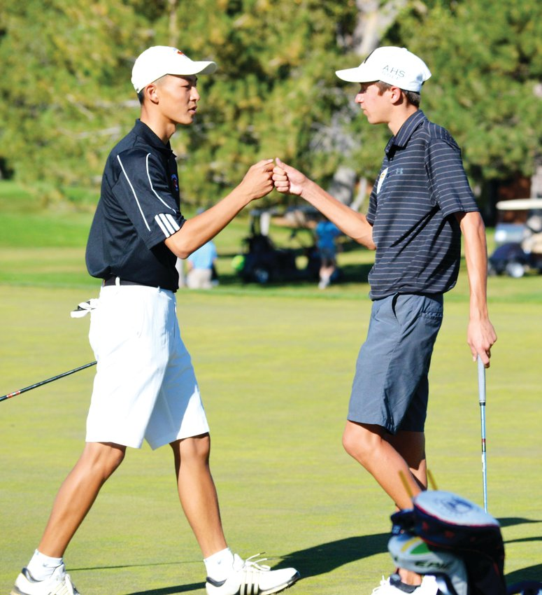 Lakewood's Ryan Liao (left) and Arapahoe's Will Kates congratulate each other after finishing on the 18th hole on Oct. 8 during the final round of the Colorado High School Boys Golf Championships at Pinehurst Country Club. Kates was the individual state champion after rounds of 71 and 66 to finish at 3-under-par 137. Liao tied for third following two rounds of 72.