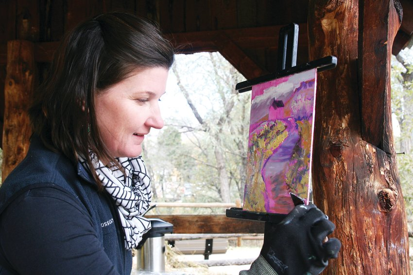 Nikki Neinhuis of Golden paints the Guy Hill schoolhouse at the Golden History Park during Foothills Art Center's Open Studio paint out at the history park on Oct. 18.