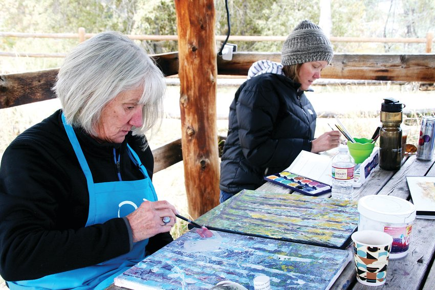 In the front, Cathy Jones of Evergreen paints a scene of Aspen trees and the Golden History Park's blacksmith barn while Lori Collins paints a landscape of South Table Mountain during Foothills Art Center's Open Studio paint out at the history park on Oct. 18.
