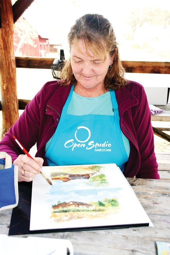 Janet Kucks of Arvada paints a watercolor landscape of the Golden History Park during Foothills Art Center's Open Studio paint out at the history park on Oct. 18.